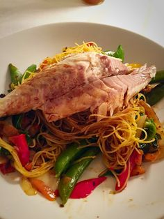 Seabass with Singapore noodles and stir fry veg in black bean sauce