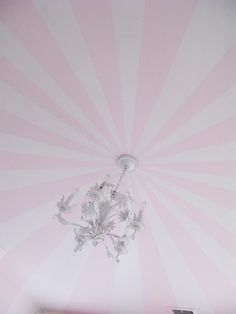 This magnificently beautiful pink and white ceiling with shabby chic chandelier make our hearts happy. So well done and quaint.