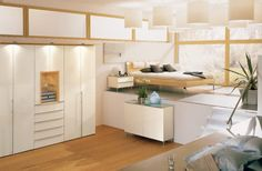Elegant White Bedroom Design With Wooden Floor And Drum Pendant Light And Indoor Plant Decorations From Hulsta