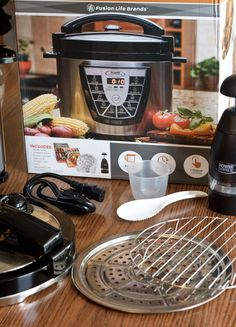 The 8 quart Power Pressure Cooker XL I bought at Costco came with a trivet, steamer tray, ladle and measure cup.
