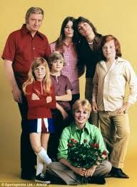 The Partridge Family was my favorite for many years, due to my huge crush on David Cassidy!  My wall was covered in his posters, I had all their albums, bought all their trading cards, you name it!