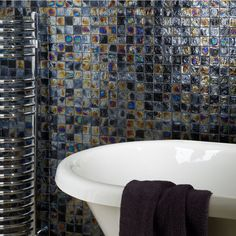 The Diesel Black Square Glass Mosaic is perfect for creating a modern and bold look in your home. It can be used as Bathroom, Kitchen and Conservatory wall tile to give any room a unique feature.