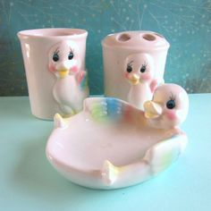 "Vintage Duck Bathroom Set  - Soap Dish Cup, by 5and10vintage on Etsy, $22.00/ $10 US ship. Fun adorable bathroom set w/ happy ducks!  Soap dish measures 5 1/4"" long.  Toothbrush holder and cup are about 3 1/2 inches high.  Cream colored ceramic with airbrushed accents.  Great vintage condition, no chips, crazing or nicks.  No markings."