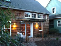 Homeowner Kol Peterson provided these photographs of his appealing shingled cottage. It is an accessory dwelling unit (ADU), a small house built in the back yard of an existing house. ADU's g…