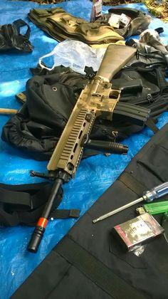 AGM HK416 with fixed stock and custom desert camo paintjob.