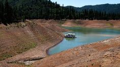 A lone houseboat beside an almost dry section of the Shasta Lake reservoir (due to the drought) in California last May.   This article discusses the increased threat of radon poisoning caused by the drought and ways to deal with it.