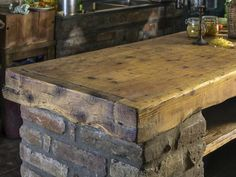 Natural elements like reclaimed brick and lumber can bring an industrial, rustic feel to a kitchen island's style. More! http://www.ourtowndowntown.net