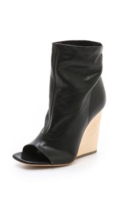 so cute these wedge booties. wish they weren't so such a high heel - that just doesn't fly with me anymore.