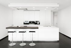 Small white kitchen with three bar chairs. More pictures of this house: http://www.worldofarchi.com/2013/05/modern-architecture-in-average-sized.html