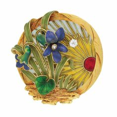 Art Nouveau Gold, Plique-a-Jour Enamel, Enamel and Diamond Brooch  18 kt., the circular mount with fluted gold frame, highlighted by a plique-a-jour blue and yellow enamel sunrise emanating from the burnt red enamel sun, surmounted by green enamel leaves outlined in gold and two purple enamel flowers, centering one small rose-cut diamond, one stem tipped by one old European-cut diamond, accented by a green guilloche enamel clover, atop a jagged patch of textured gold, circa 1905.