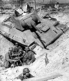 Stalingrad. A German mortar team set-up next to a knocked Russian T-38.