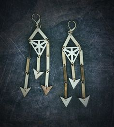 These geometric hand fabricated statement earrings are made with polished and treated brass. The brass is treated with a special brass wax to preve...