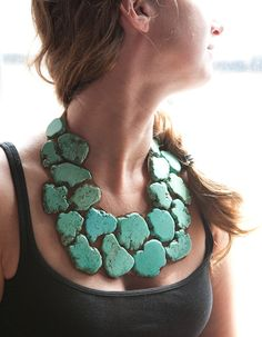 This handmade necklace is made from large beautiful turquoise stones and brown leather.