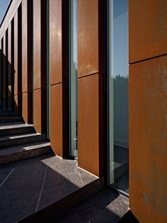 Here is corten steel. I'll pin more images because it can look different in various lighting conditions and can come really dark in an almost purple-ish hue.