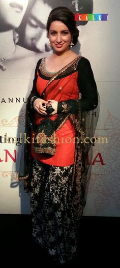 http://www.kalkifashion.com/ Tisca Chopra attinding TIFF where her movie is being showcased turned up in a Sabyasachi orange and black suit.