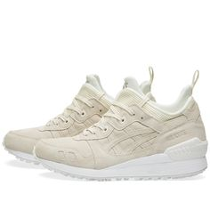 Asics' Gel-Lyte MT builds on the signature design of the Gel-Lyte III, updating it for the winter months by giving it a higher profile. The sock-like inner features the standard neoprene construction whilst a soft suede features to the upper. A mesh underlay and ballistic mesh to the tongue complete the design.  Suede Upper Mesh Underlay Ballistic Mesh Tongue Split Tongue Construction Gel-Respector™ Heel Clip Speckled Midsole Rubber Outsole Style Code: HL6F4-9999