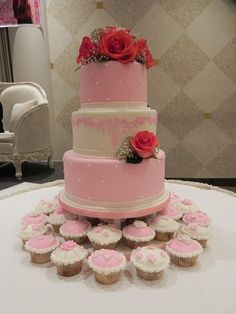 Amazing pink and white cake with lovely cupcakes made by Cake by Cheryl