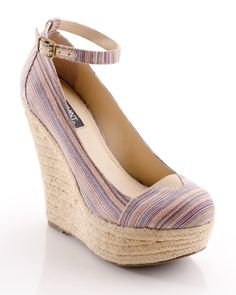 Comfort and casual chic, an espadrille inspired wedge with a Mediterranean vibe.