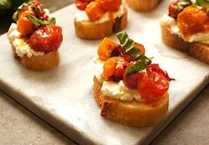 Honey Balsamic Tomato Crostini made with cherry tomatoes roasted until they are nearly candied, over good ricotta on toasted baguette. Recipe on Mom's Kitchen Handbook.