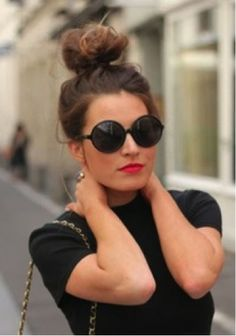 Pair a top knot with killer sunglasses and a bold lip for a look that's street style chic!