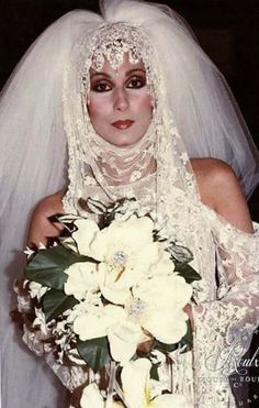 Cher as a Bride in a Celebrity Fashion Show - wearing a Bob Mackie creation