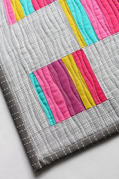 Mini Scrappy Quilt ~ what fun to use up your scrap fabrics!  I really think the machine quilting made this quilt!