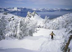 Skier above beautiful alpine lake
