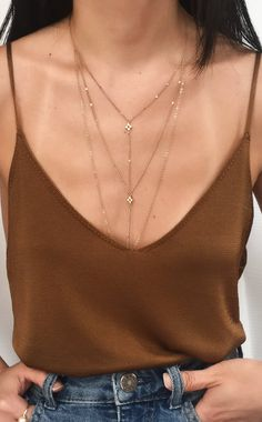 Pairing a lariat with a tank like this one will truly make you stand out