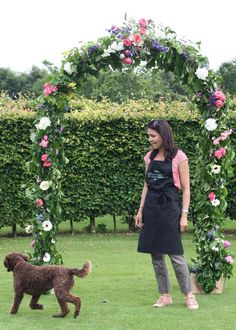 Rustic arch full of beautiful bright blooms for a July wedding at Wedderburn Castle. Contact The Stockbridge Flower Company, Edinburgh for more details