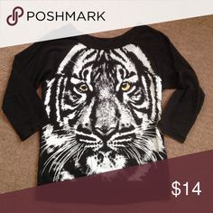 Tiger top Lightly worn tiger top with gold eyes. 3-quarter sleeves Tops