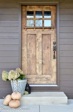 fall decor - front door decorated with pumpkins and dried hydrangea.