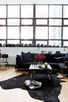 The Dark Side: Neo Goth Royalty at Home in Brooklyn : Remodelista - row of black helmets