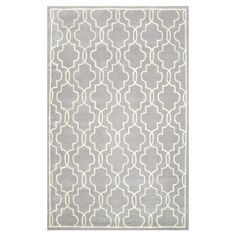 Anchor your living room seating group or define space in the den with this hand-tufted wool rug, featuring a quatrefoil-inspired ogee motif for eye-catching ...