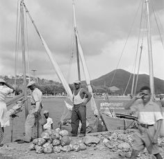 Local men work at the dock in Charlotte Amalie, St. Thomas, US Virgin Islands.