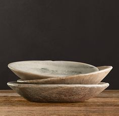 """Vintage Indian Stone Bowls  Hand carved from sandstone and marble, our bowls once served as everyday vessels in northern India. The unique patina of age and use, along with the natural textures of the stones, make them one-of-a-kind decorative accents.  8""""-12"""" diam. x 1½""""-3""""H   Weight: approx. 2.5 lbs."""