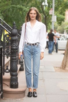Sorry, Skinny-Jean Loyalists: These Are The New Normal #refinery29  http://www.refinery29.com/mom-jeans-outfits#slide4  One way to automatically make your jeans look more polished is to pair with a structured belt and loafers.