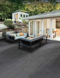 Mode paving is the epitome of contemporary style. A range of beautiful porcelain paving that adds an ultra modern feel and look to any garden setting.   Don't be deceived by the word porcelain. Fired at up to 1400°C, these pavers boast an incredible inherent strength and exceptional durability. This, combined with the fine textured and anti-slip finish, makes Mode paving a viable, premium alternative to both concrete and natural stone. Bradstone Paving, Paving Stones, Concrete Backyard, Patio Planters, Contemporary Style, Modern, Planter Ideas, Design Concepts, Patio Design