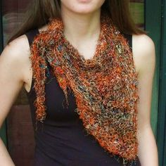 The Silk Bandana Scarf is lightweight, making it the perfect free scarf pattern for spring. Experiment with various art yarns to create a work of art.