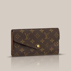 Sarah Wallet Monogram Canvas This envelope-style wallet combines an elegant exterior in Monogram canvas with an ingeniously designed interior featuring a variety of pockets and credit card slots.