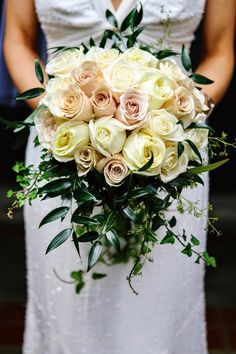 cascading bouquet with ivy, italian ruscus and roses of ivory and blush