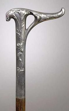 Lady's Walking Stick 1870;, 800 Silver Art Nouveau Handle, German?  A lady's walking stick having a typical art nouveau floral design on 800 coin silver handle with illegible continental hallmarks. Cane is probably German/Austrian