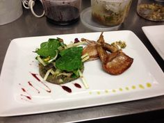 Quail entree at work !!!! Eggplant caviar with portwine reduction ,spinach and apple salad with pistachio