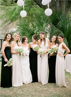 will do something similiar.... but since I only pan on having a few bridesmaids. Maid of Honor gets one color everyone else gets the other.