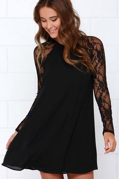 Sometimes a little lace is all it takes to to make a frock really fabulous. Case in point: the Lace In Point Black Lace Shift Dress! Sheer lace long sleeves take this traditional woven shift dress up a notch, for a fancy touch to take you from day to night. A rounded neckline works its magic, while an open back keyhole with top button closure provides a peek of skin. Body of dress is lined. Model is wearing a size small. 100% Polyester. Hand Wash Cold or Dry Clean. Imported.
