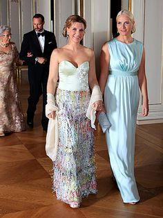 Crown Princess Mette-Marit and Princess Märtha Louise arrive for the official banquet at the Royal Palace