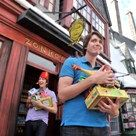 Oliver and James Phelps (L to R)who portray the mischievous Weasley brothers, George and Fred respectively, in the Harry Potter films stopped into Zonkos in Hogsmeade at The Wizarding World of Harry Potter on June 9.