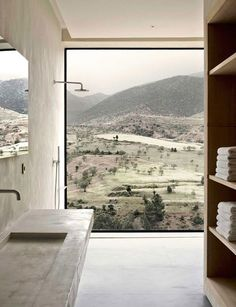 Villa E is a stunning mountain lodge built on the foothills of the Atlas Mountains, Morocco, by French designers Studio Ko. They designed the house with respect towards its landscape and a minimalist
