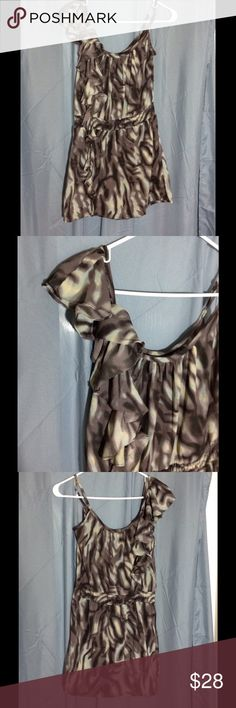 Semi sheer asymmetrical dress Fabric is semi sheer.  Teal and grey pattern.  Ruffles on right shoulder continue down the front of the dress.  Elastic waist.  Envy Me brand. Envy Me Dresses Asymmetrical