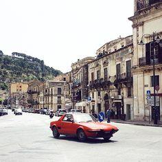 Vintage red in #Modica #sicily #sicilia #italy #vscocam #vscourban #wanderfolk #travelgram #stellerstories #instagramhub #mytinyatlas #neverstopexploring #finditliveit #beautifuldestinations #cityscapes #vintagecars #liveauthentic #huntgram #ontheroad #roadtrippin