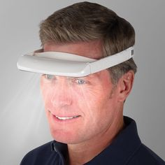 Light Therapy Visor. Just looking at this picture would cure my seasonal affective disorder. I would be as happy and handsome as this man if I wore this!